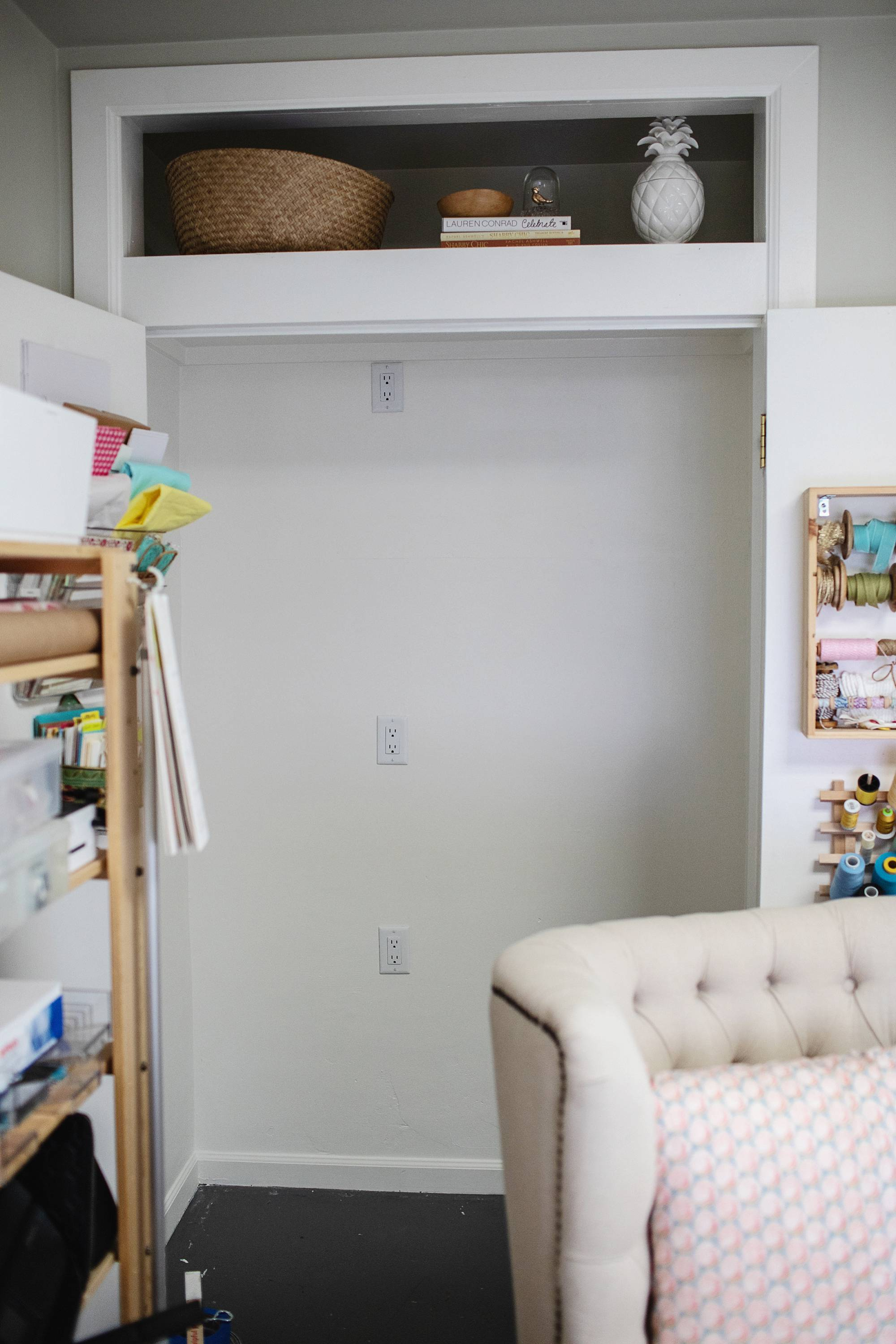 steps of the remake of my office closet with outlets before wallpaper