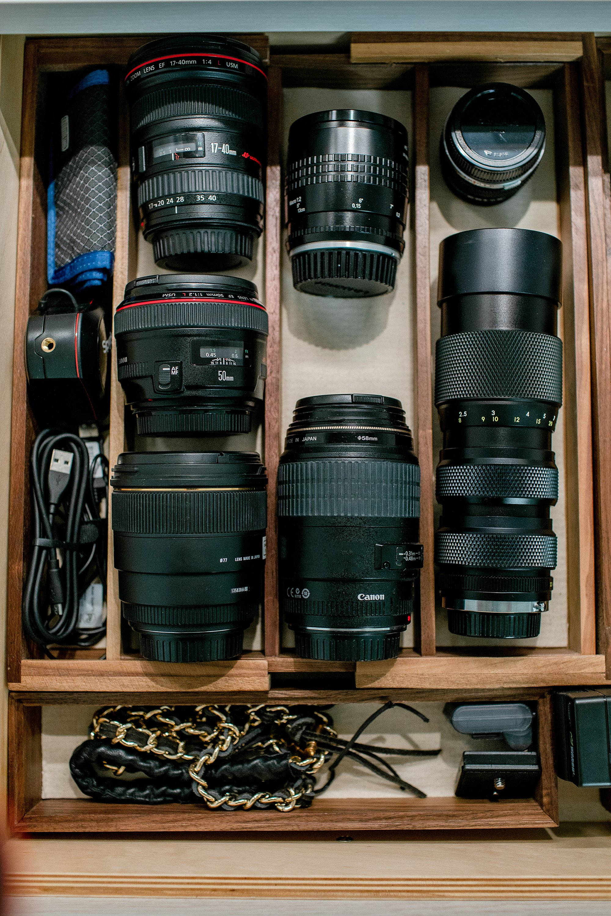 organizing lenses in a drawer. see this reveal in a photographer's home office closet and organizing camera lenses in drawers #photography #lensdrawer #lenses #organization