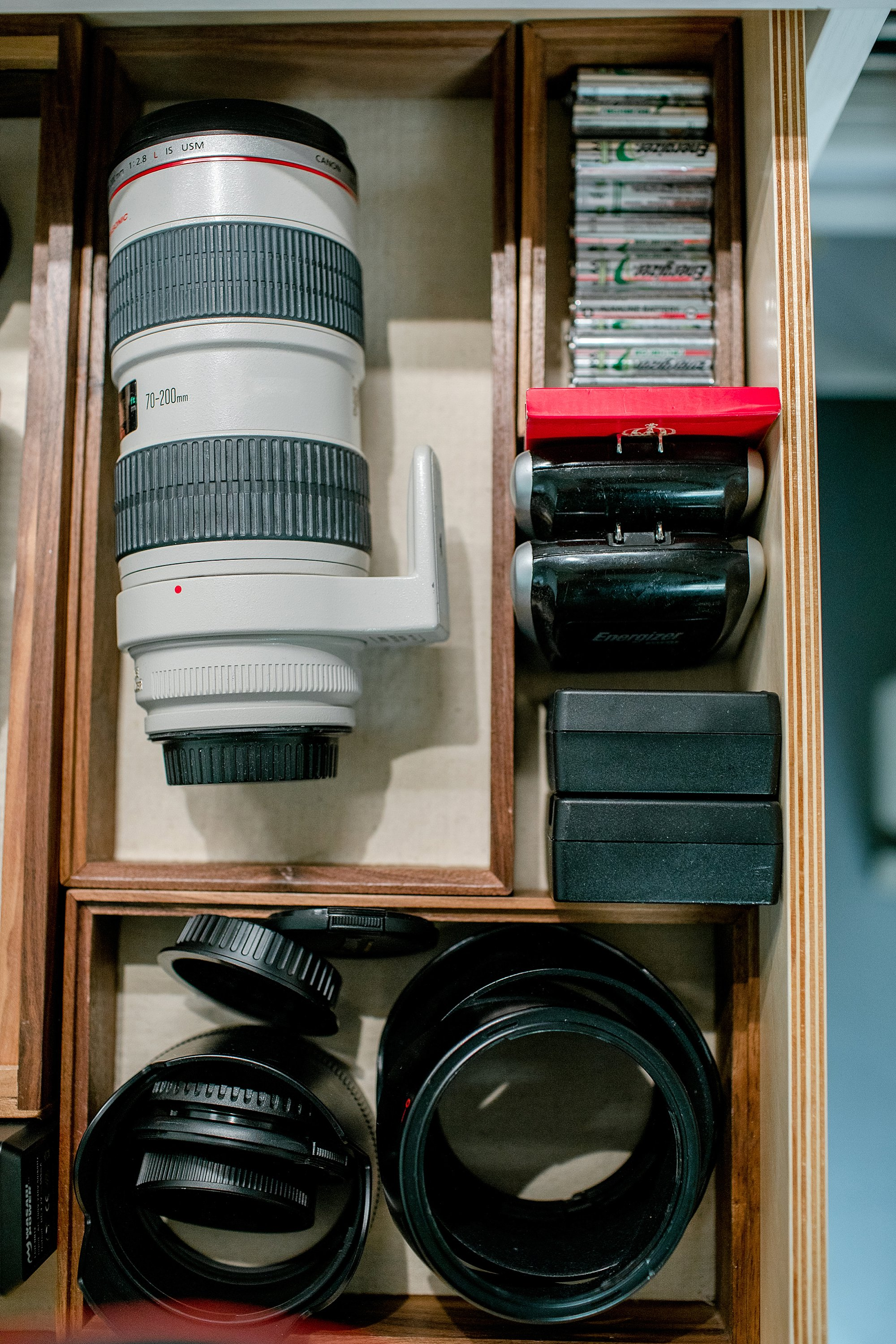 camera lens organization and batteries and accessories using utensil drawer organizers, see more on the blog post #organization #lenses #photography #photostudio