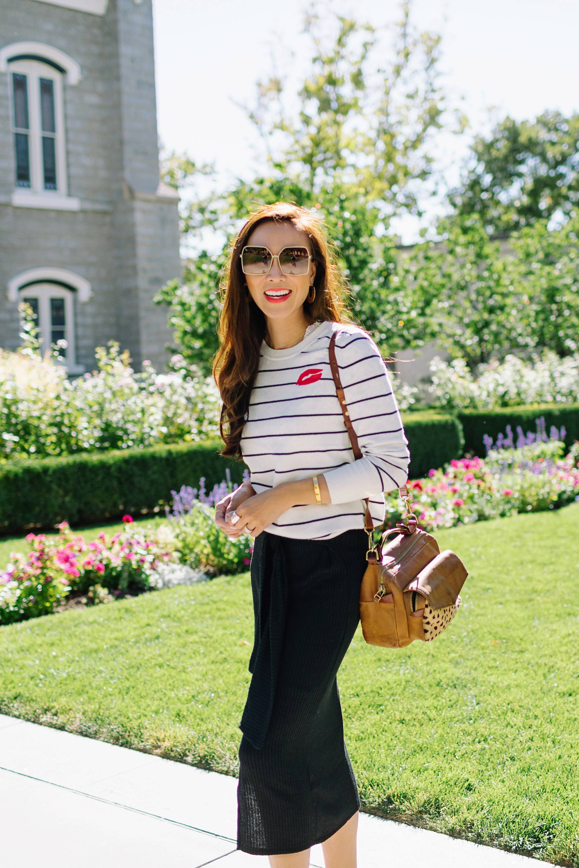 wearing black white stripe sweater banana republic and knit skirt black on lifestyle fashion blogger Diana Elizabeth phoenix arizona and white sneakers