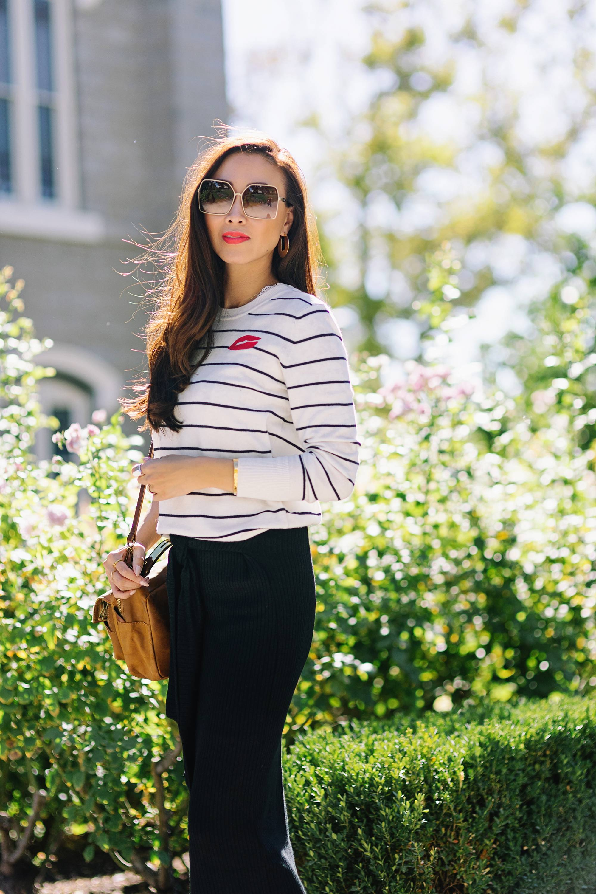 wearing black white stripe sweater banana republic and knit skirt black on lifestyle fashion blogger Diana Elizabeth phoenix arizona and white sneakers red lips from dose of colors coral