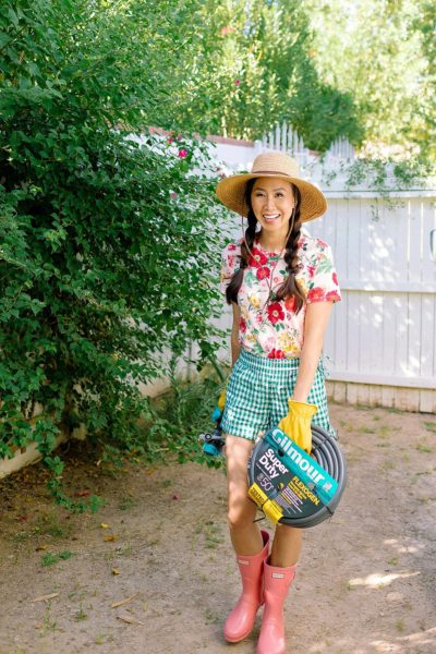 FAQ on our backyard and gardening on the blog roundup post. lifestyle garden blogger Diana Elizabeth from phoenix arizona wearing floral top and gingham shorts