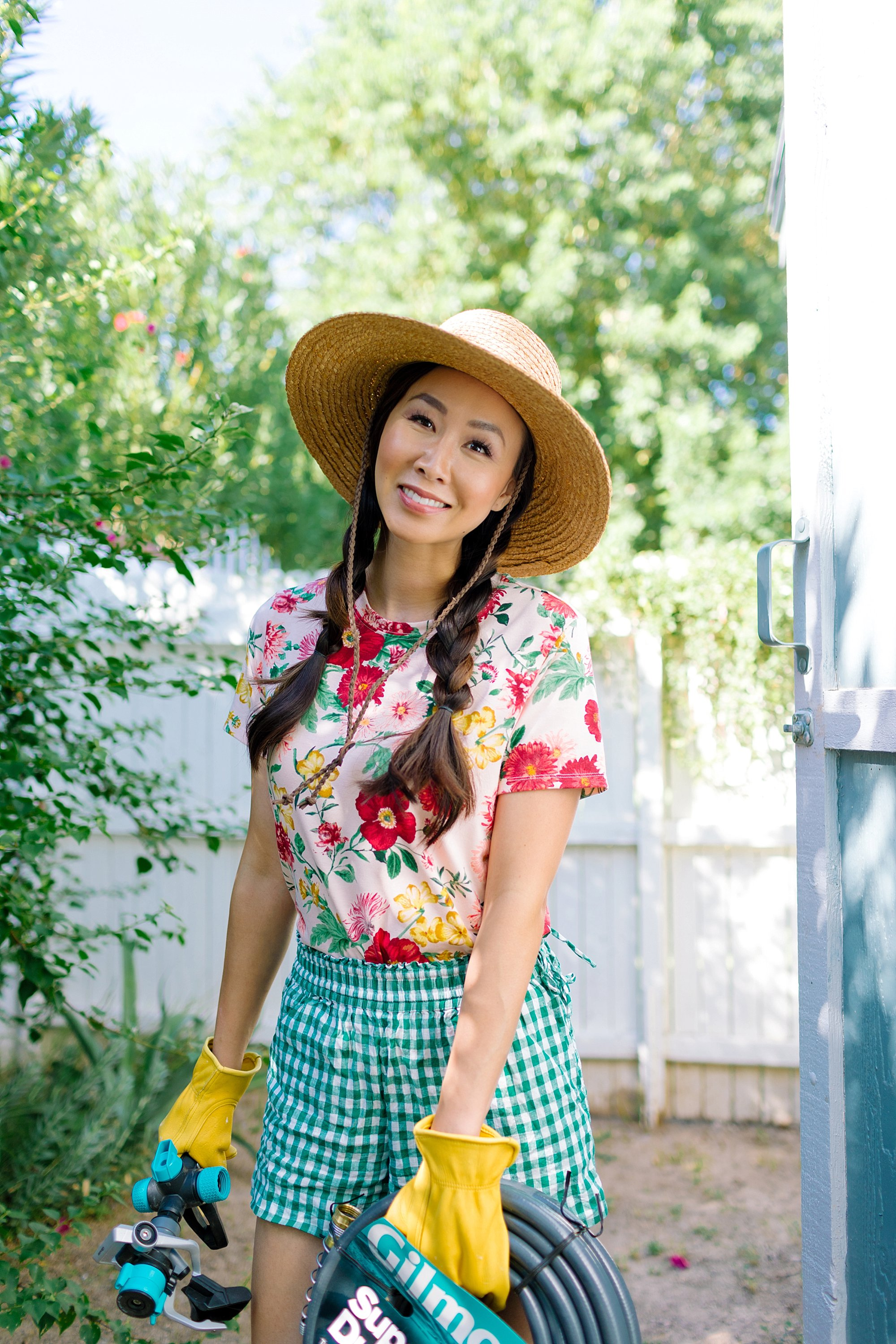 Garden preparation with Fiskars and Gilmour flexogen hose with tool shed tour garden lifestyle blogger Diana Elizabeth phoenix arizona wearing floral shirt and gingham shorts