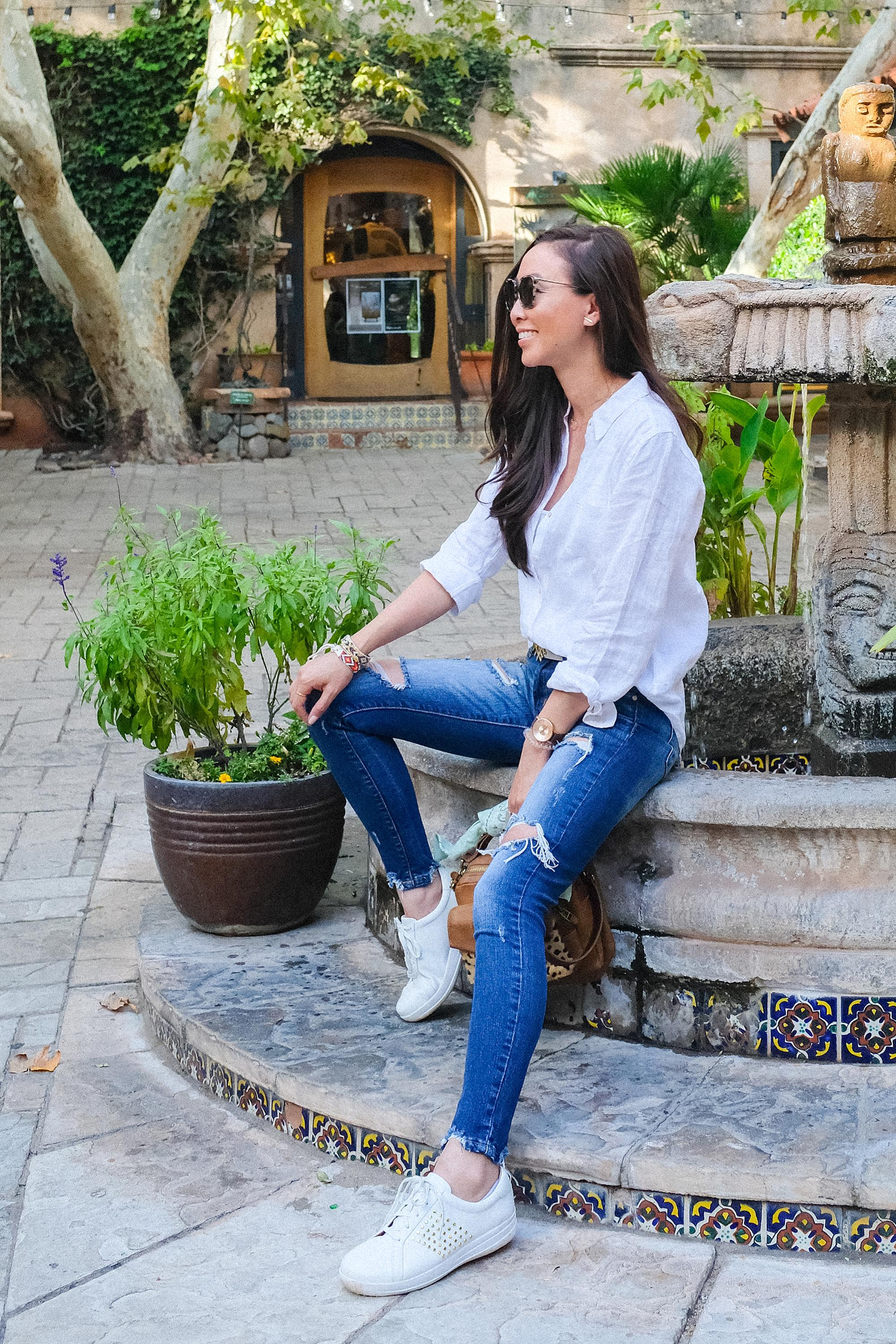 Tlaquepaque Arts & Crafts Village shopping in Sedona, lifestyle blogger Diana Elizabeth wearing white sneakers by fountain