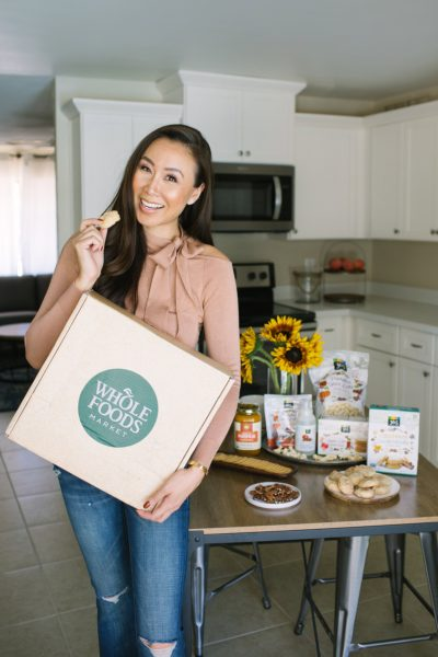 Whole Foods giveaway of best fall flavors, lifestyle blogger Diana Elizabeth in Phoenix arizona holding Whole Foods box with cookie she made