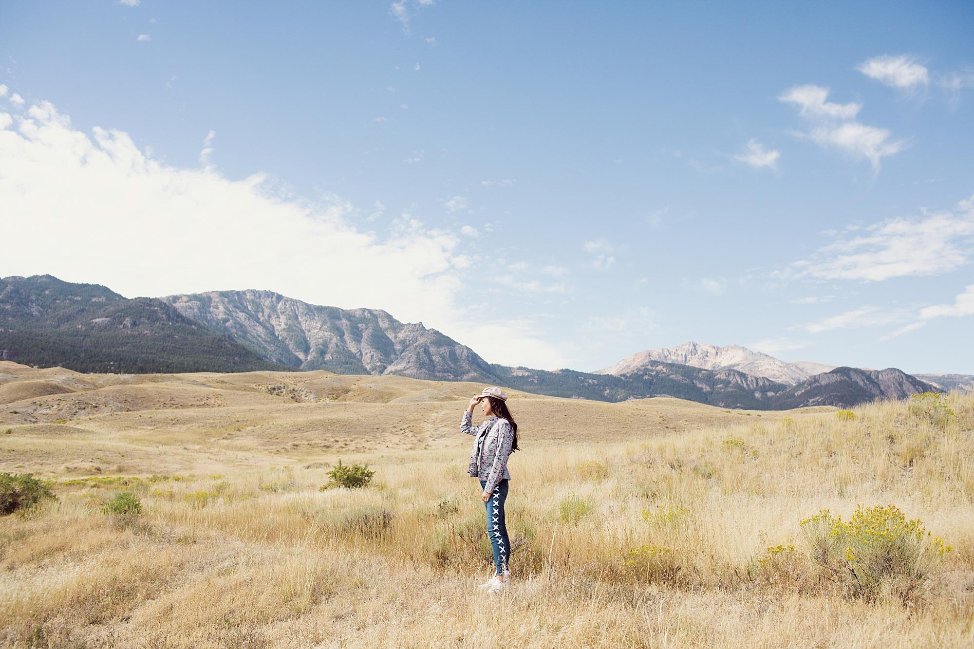 """Wyoming Yellowstone right outside the national park in an """"always wandering"""" t-shirt and lace up jeans"""