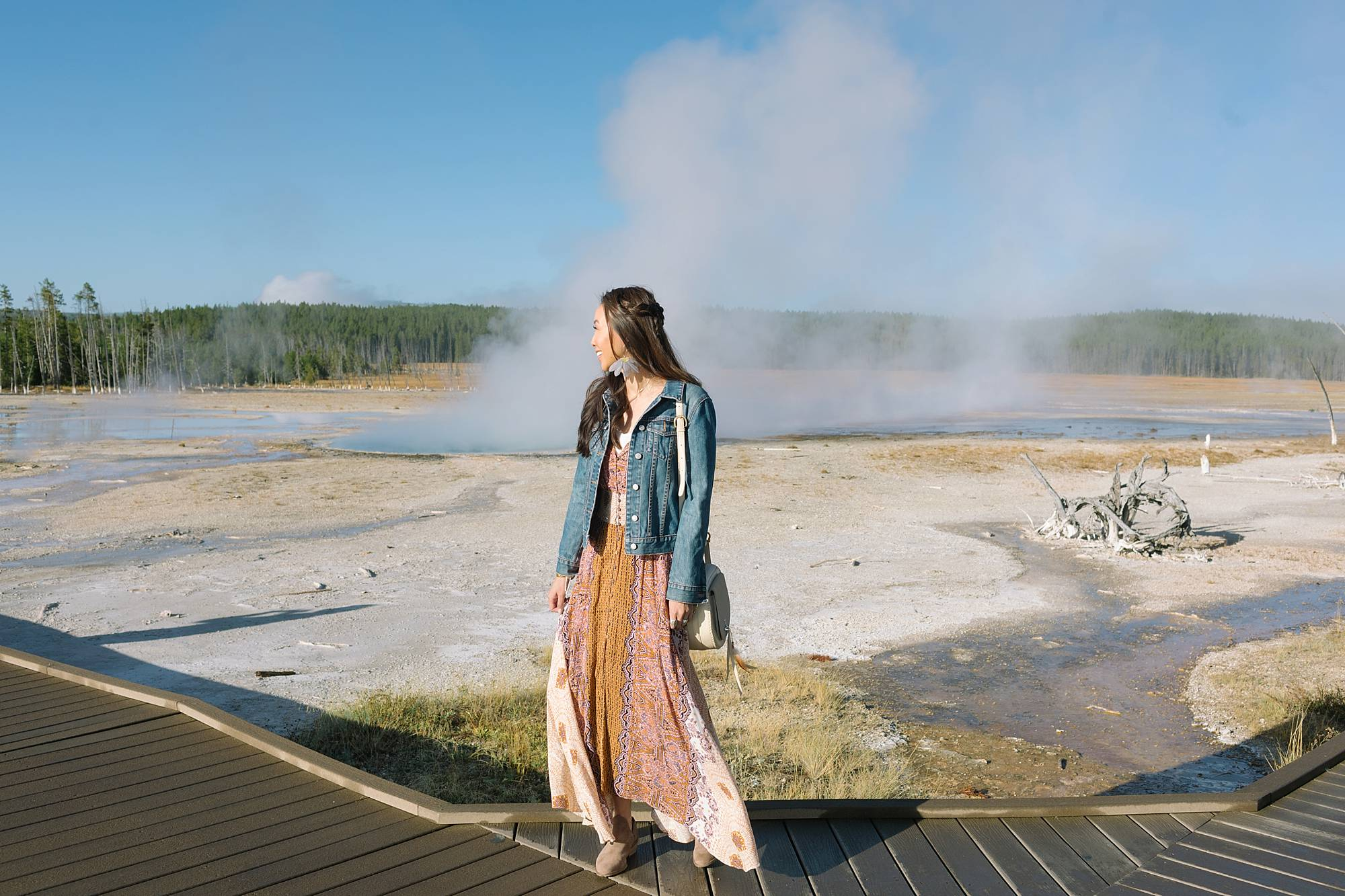 Yellowstone geysers, lifestyle blogger Diana Elizabeth in free people dress from Macy's and lucky brand booties wearing denim jacket. travel fashion inspiration post