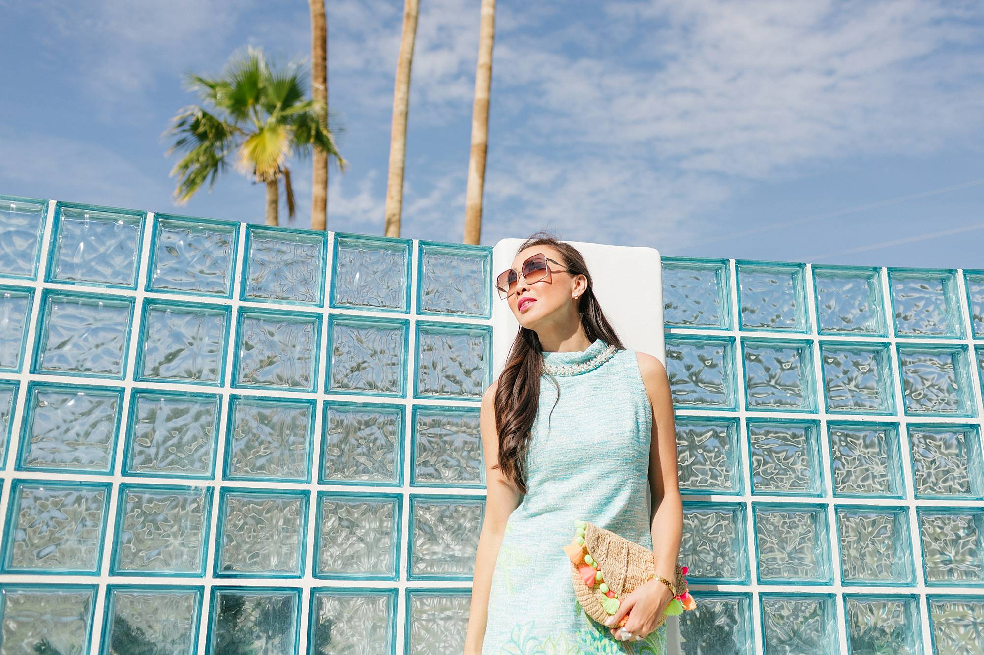 the monkey tree inn Palm Springs wearing Lilly pulitzer on phoenix travel lifestyle blogger Diana Elizabeth against blue glass wall in portia blue shift dress