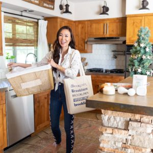 lifestyle blogger holding basket of laundry and some goodies in a babbleboxx getting home ready for thanksgiving and the holidays #kitchengoals #Kitchen