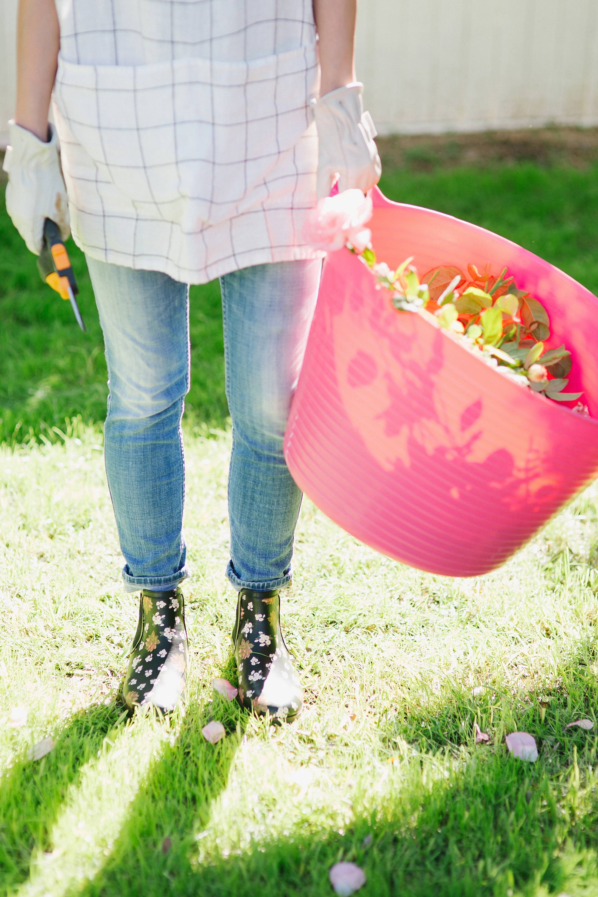 in the garden cutting roses //chai floral leather booties in black FitFlop cute booties and garden booties too with a pink tubtrug liberty London scarf in hair against white painted fence garden blog
