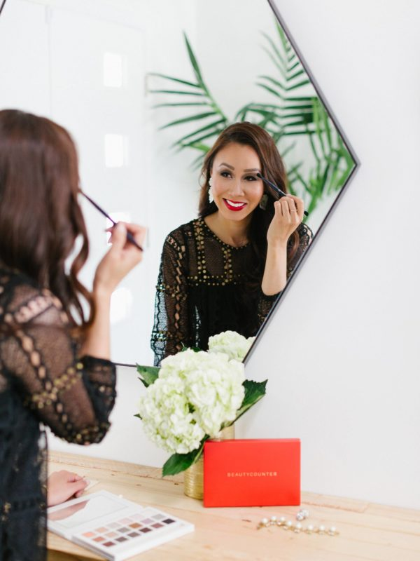 Lifestyle beauty blogger Diana Elizabeth using Beautycounter Limited Edition Holiday Necessary Neutrals Eyeshadow Palette 18 shadows a review #makeup #beautycounter Applying in front of a mirror