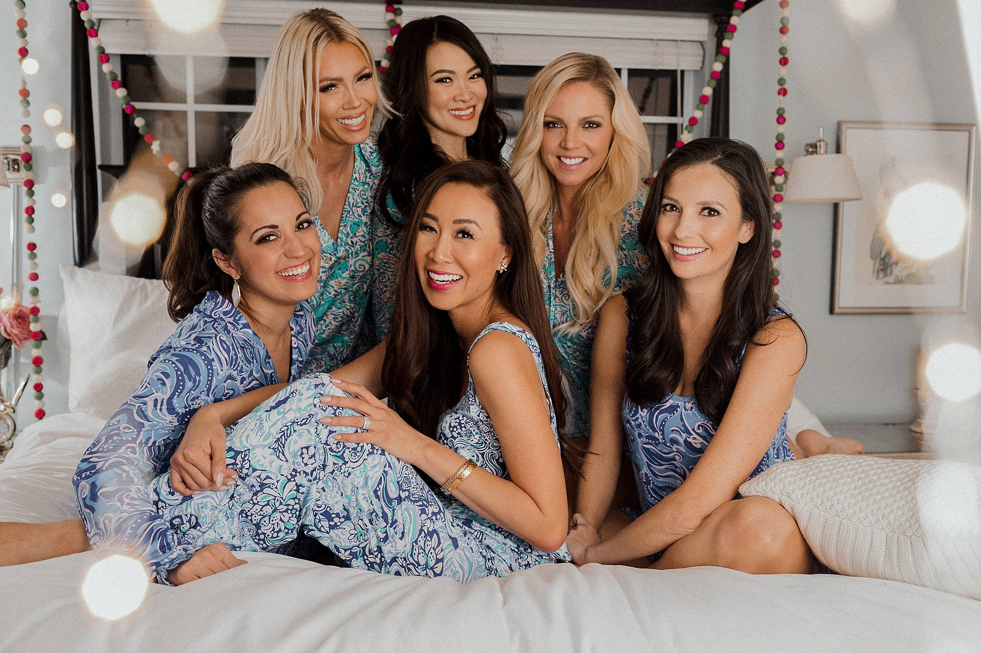 Lilly Pulitzer pajama party 2018 girls pajama Christmas party girls on bed sleepover - lifestyle blogger Diana elizabeth