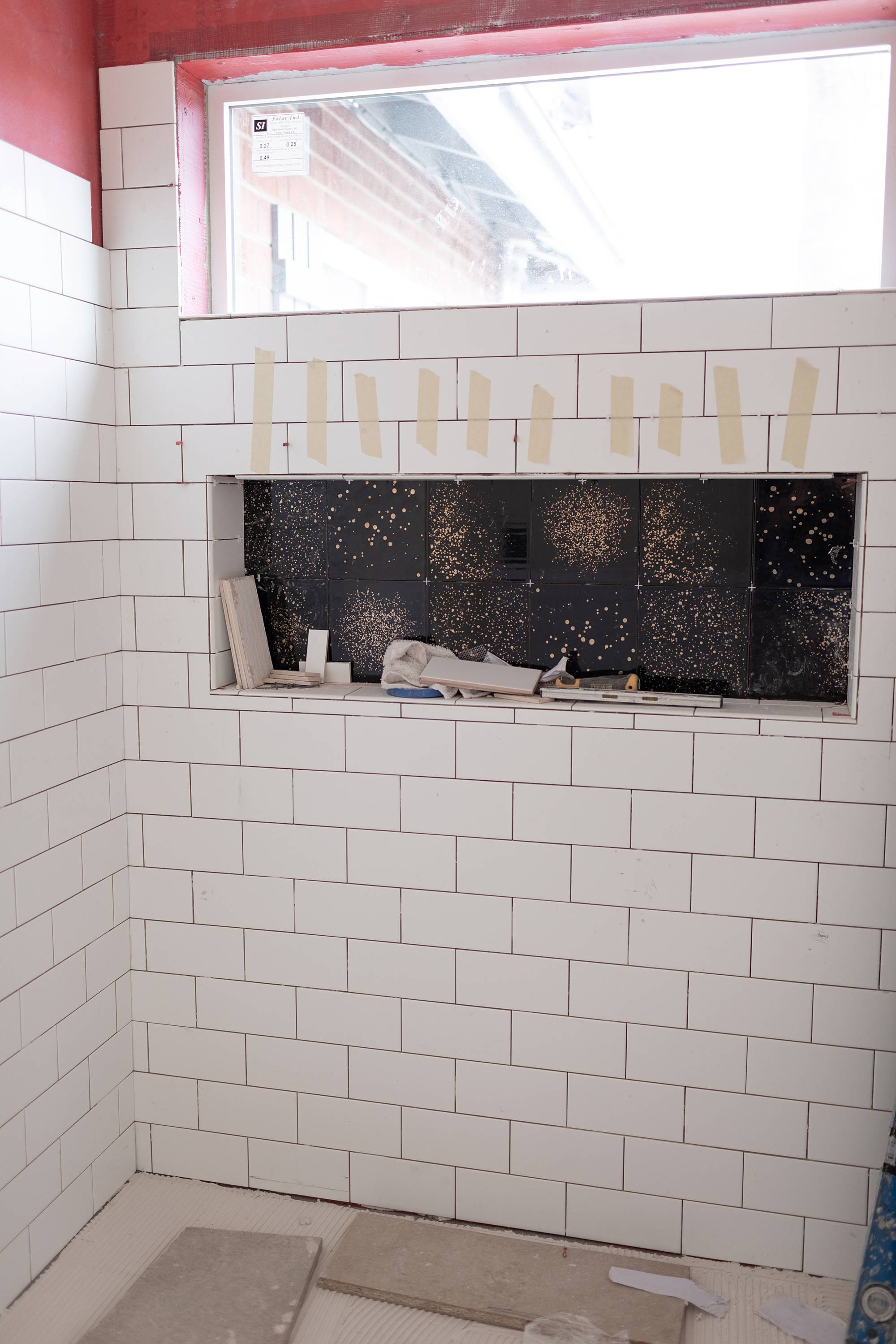 subway tile and black and gold tile