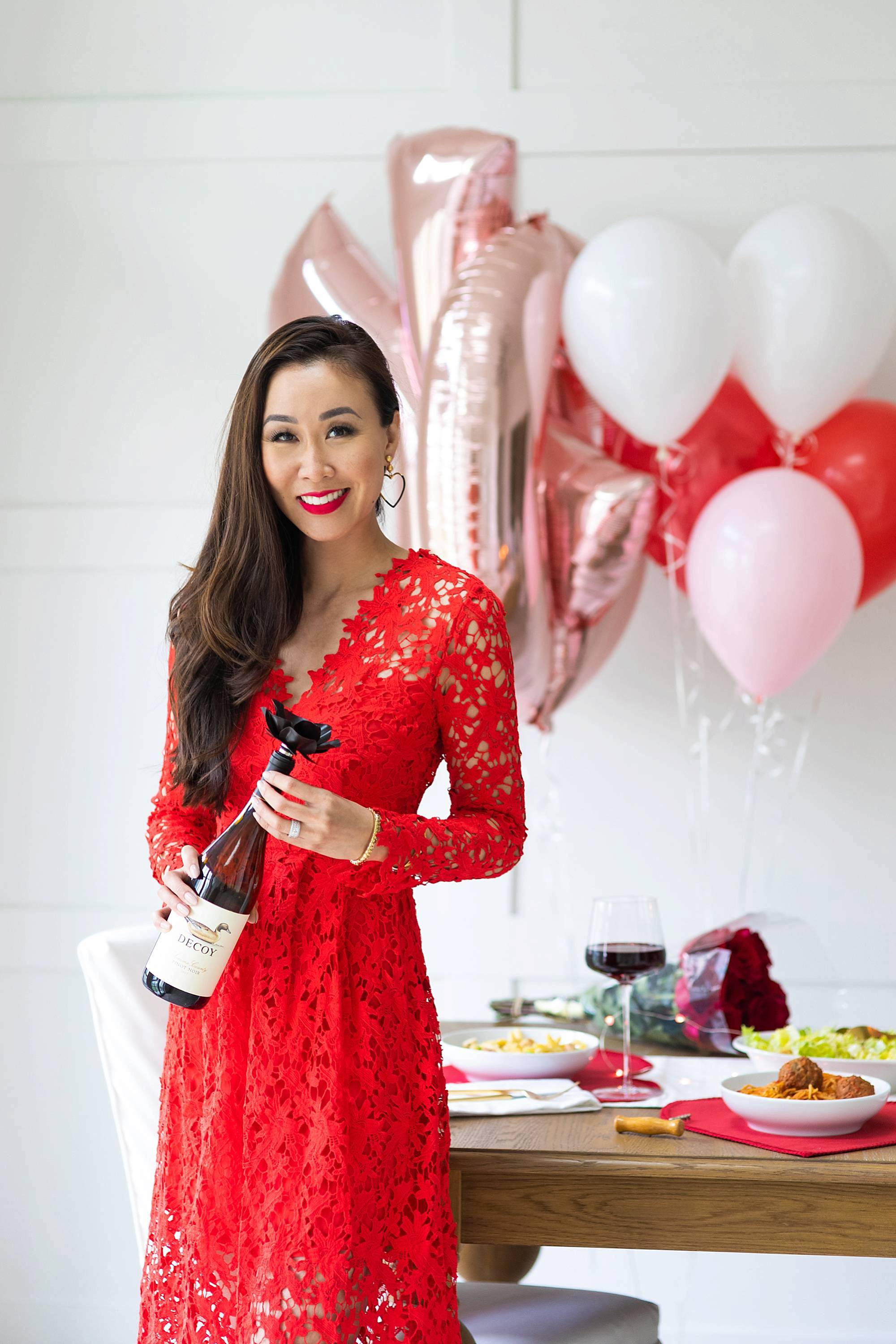 red lace dress for romantic valentines day dinner with decoy wine