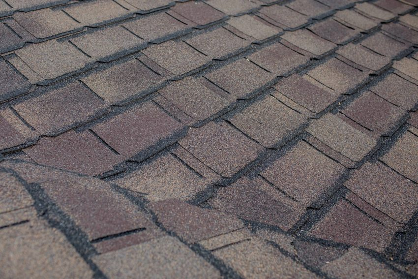 gaf roofing barkwood color roof shingles - sitting on rooftop
