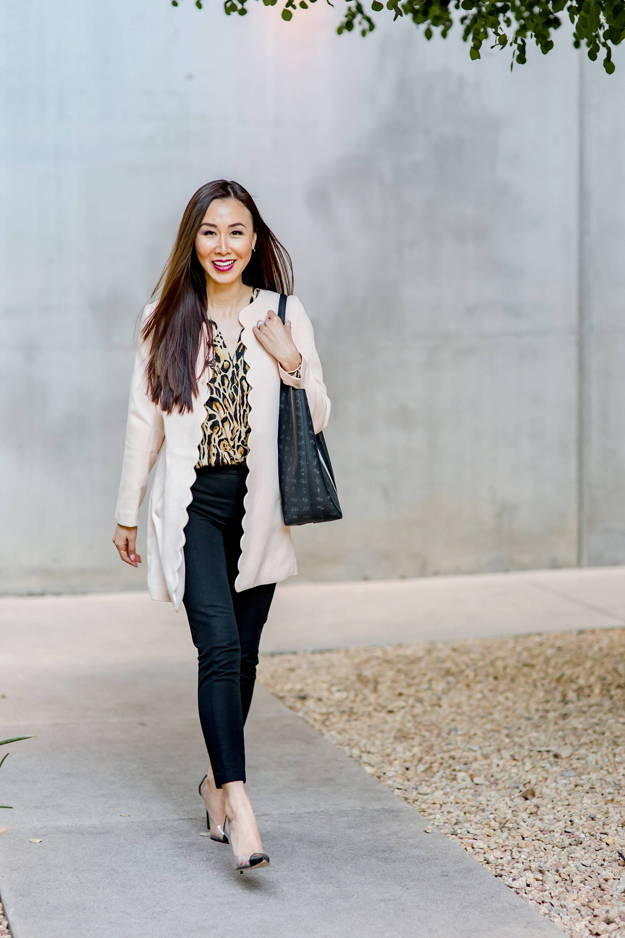 scalloped pink lightweight coat with leopard print bodysuit, clear pump heels and India Hicks tote on lifestyle blogger Diana Elizabeth in phoenix arizona