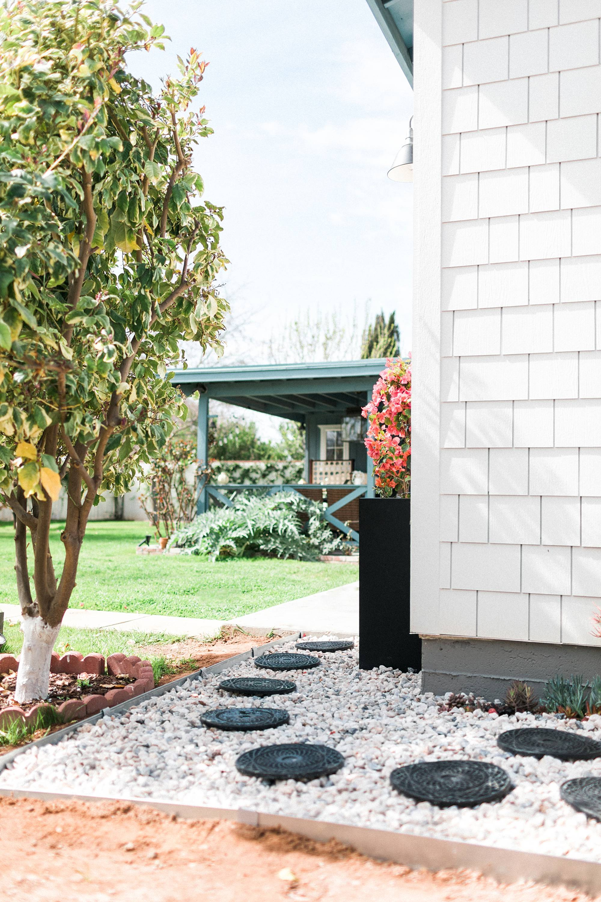 make a rocky drainage path for areas that get muddy by the hose or in the garden - a DIY how too. Alabaster white sherwin Williams white fiber cement shake shingles for siding, restoration hardware lights