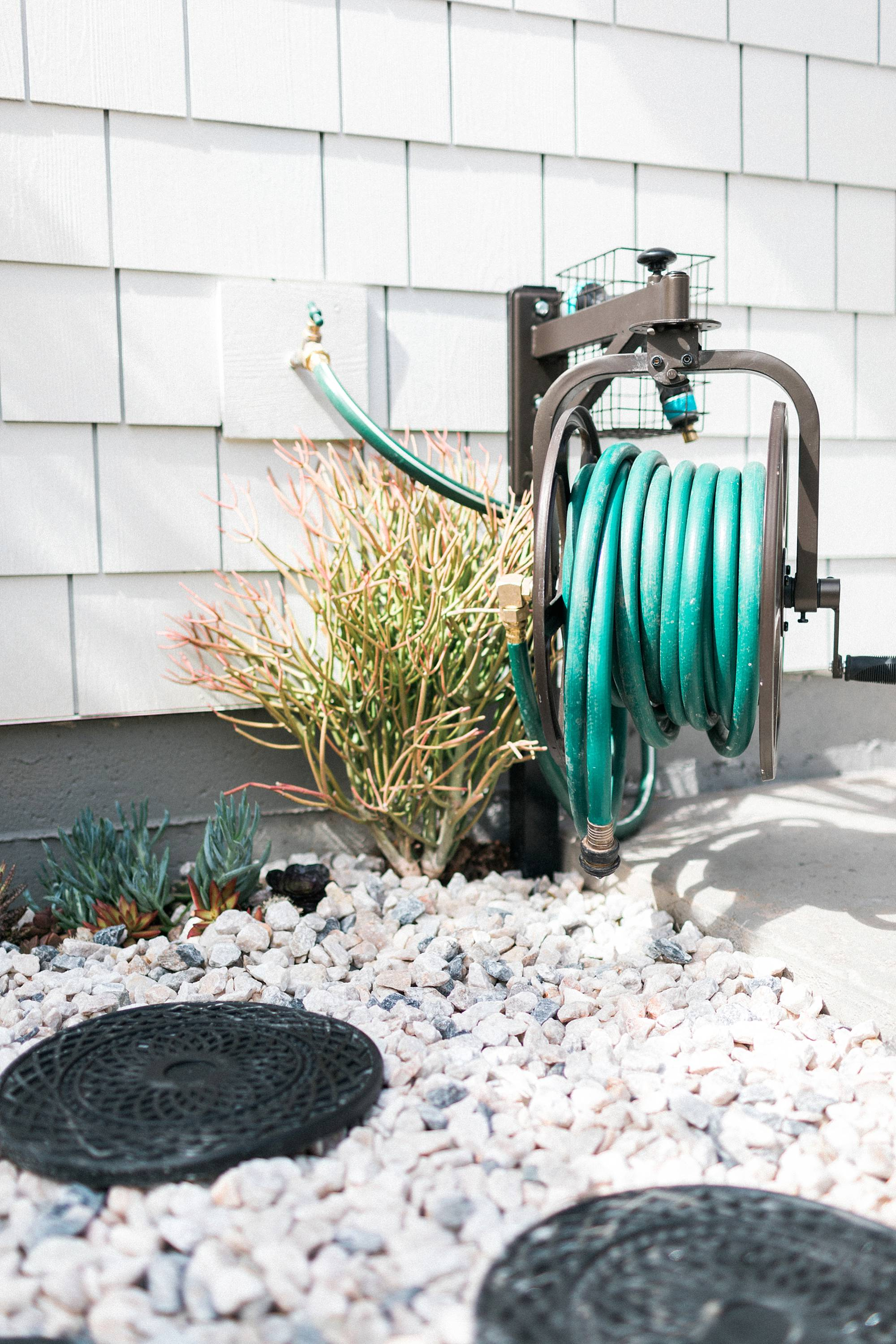 succulent garden, make a rocky drainage path for areas that get muddy by the hose or in the garden - a DIY how too. Alabaster white sherwin Williams white fiber cement shake shingles for siding, restoration hardware lights rotating hose