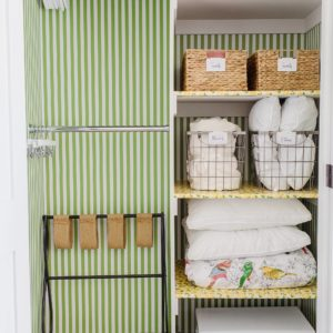 green white stripe wallpapering closet