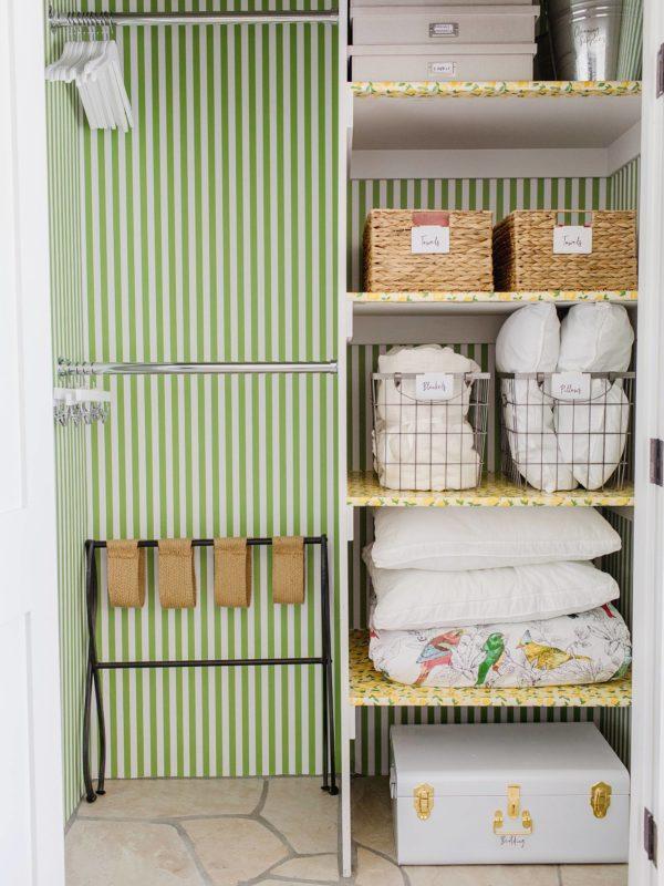 green white stripe wallpapering closet