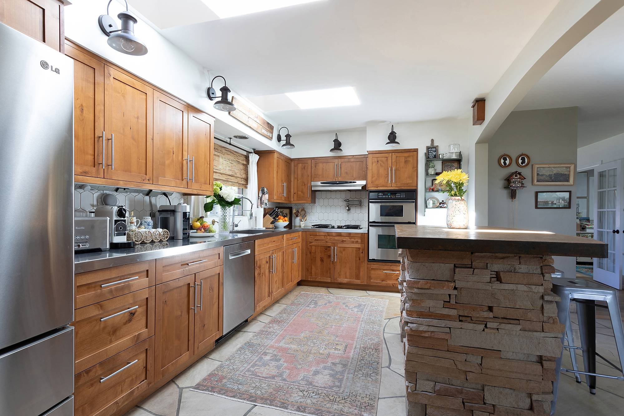 Skylights in the kitchen with VELUX - see before and after photos in this huge blog post