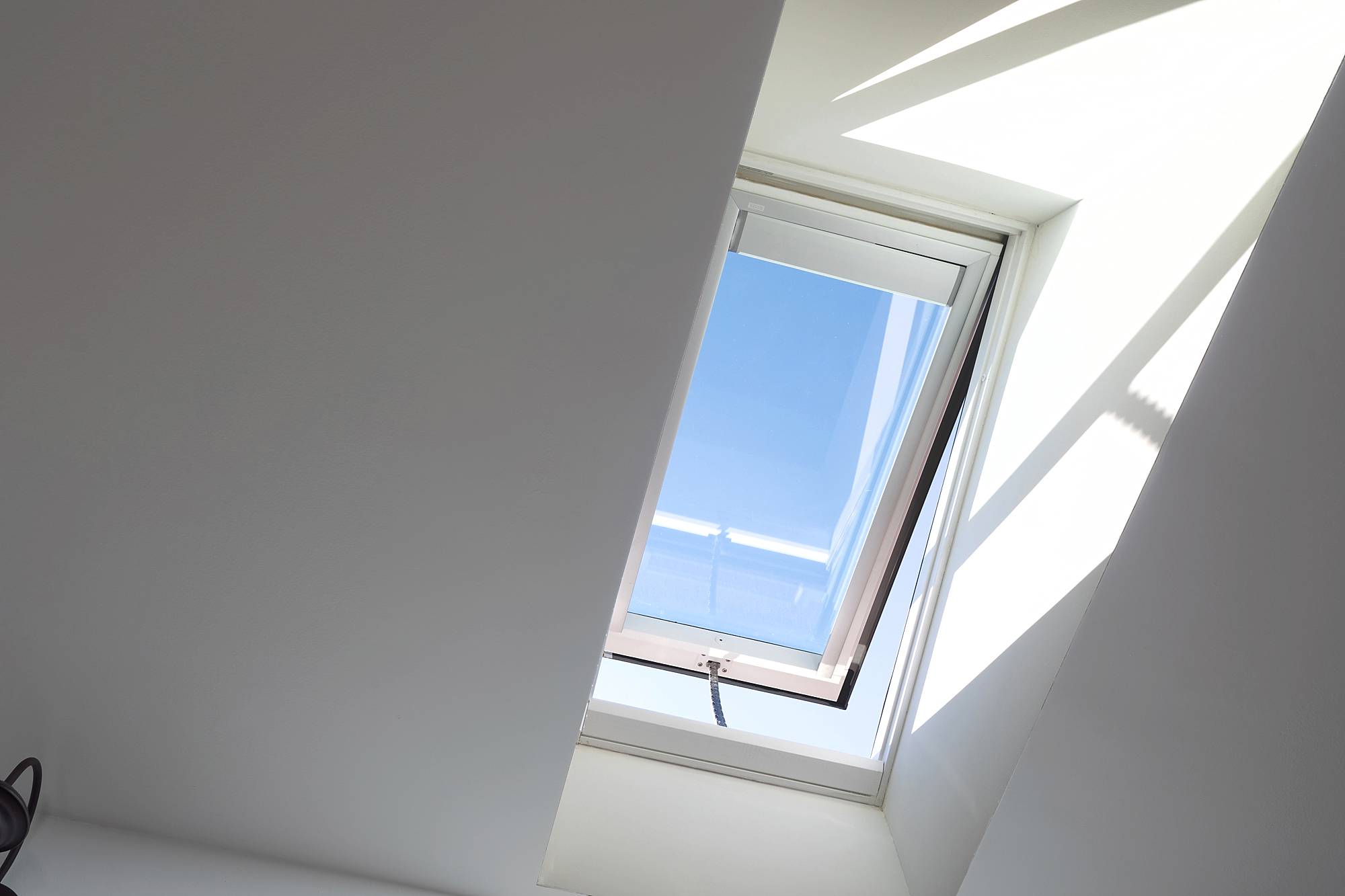Skylights in the kitchen with VELUX - see before and after photos in this huge blog post// open up skylight