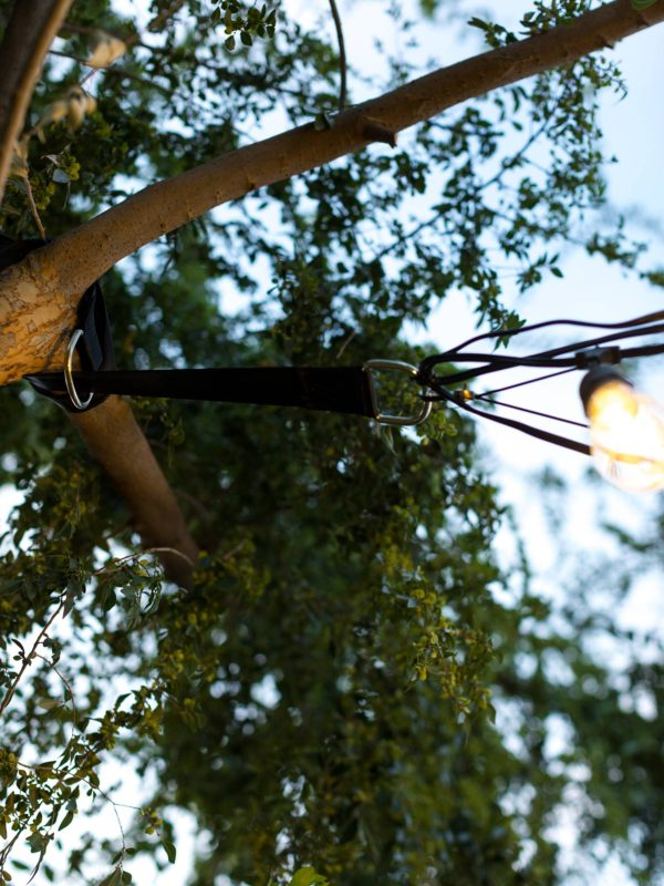 how to hang cafe string lights on cable wire in backyard - easy DIY and all the materials you need
