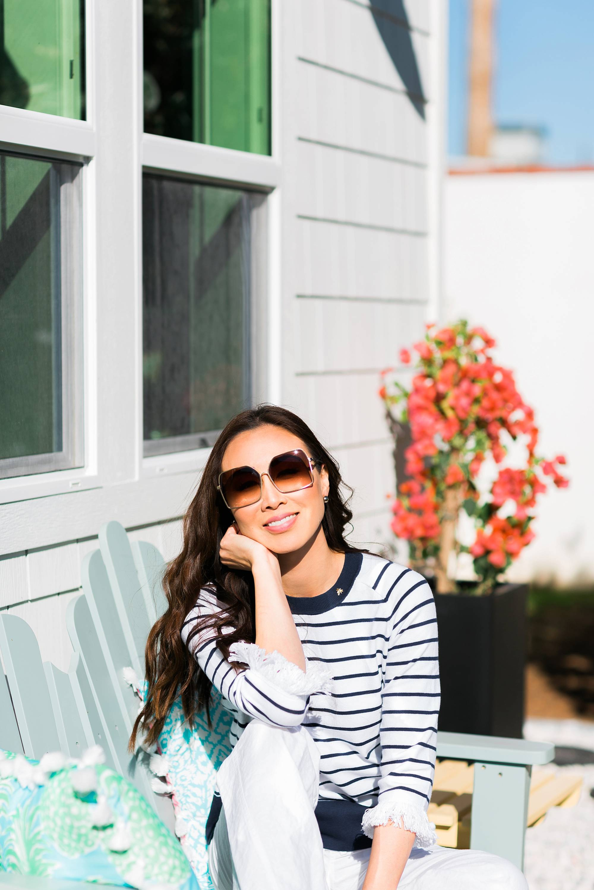 Lilly Pulitzer Dasha Sweater blue and white stripe with fringe on blogger Diana Elizabeth on bench