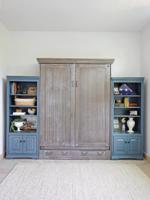 how to style and decorate a Murphy bed so it looks attractive try bookshelves