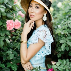 blue lace dress with garden hat from terrain nestled between pink roses against the wall - lifestyle blogger Diana Elizabeth phoenix scottsdale arizona