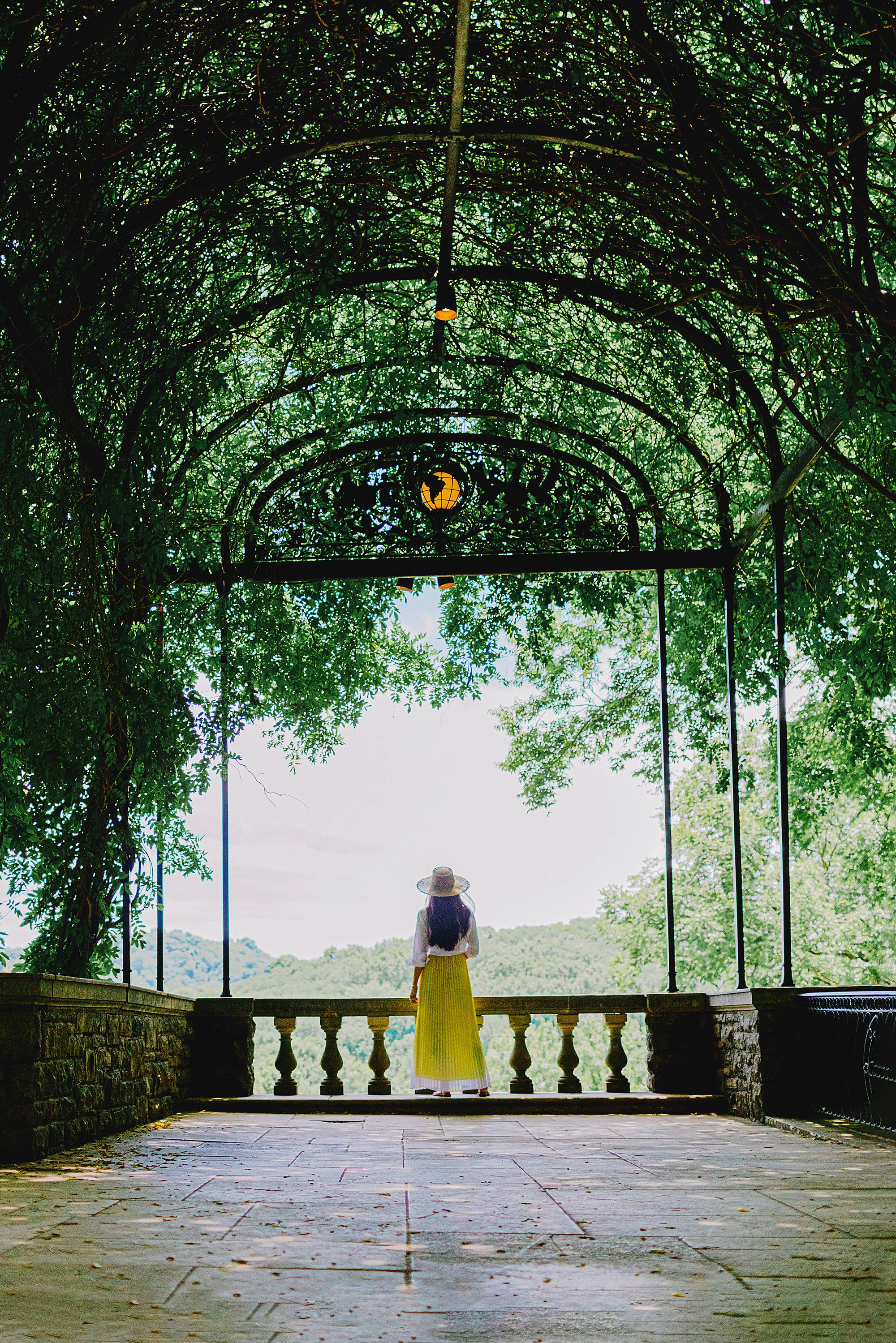 vines epic view at cheekwood in Nashville woman wearing yellow dress and hat