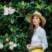 magnolia trees in Nashville standing by one safari hat and yellow dress
