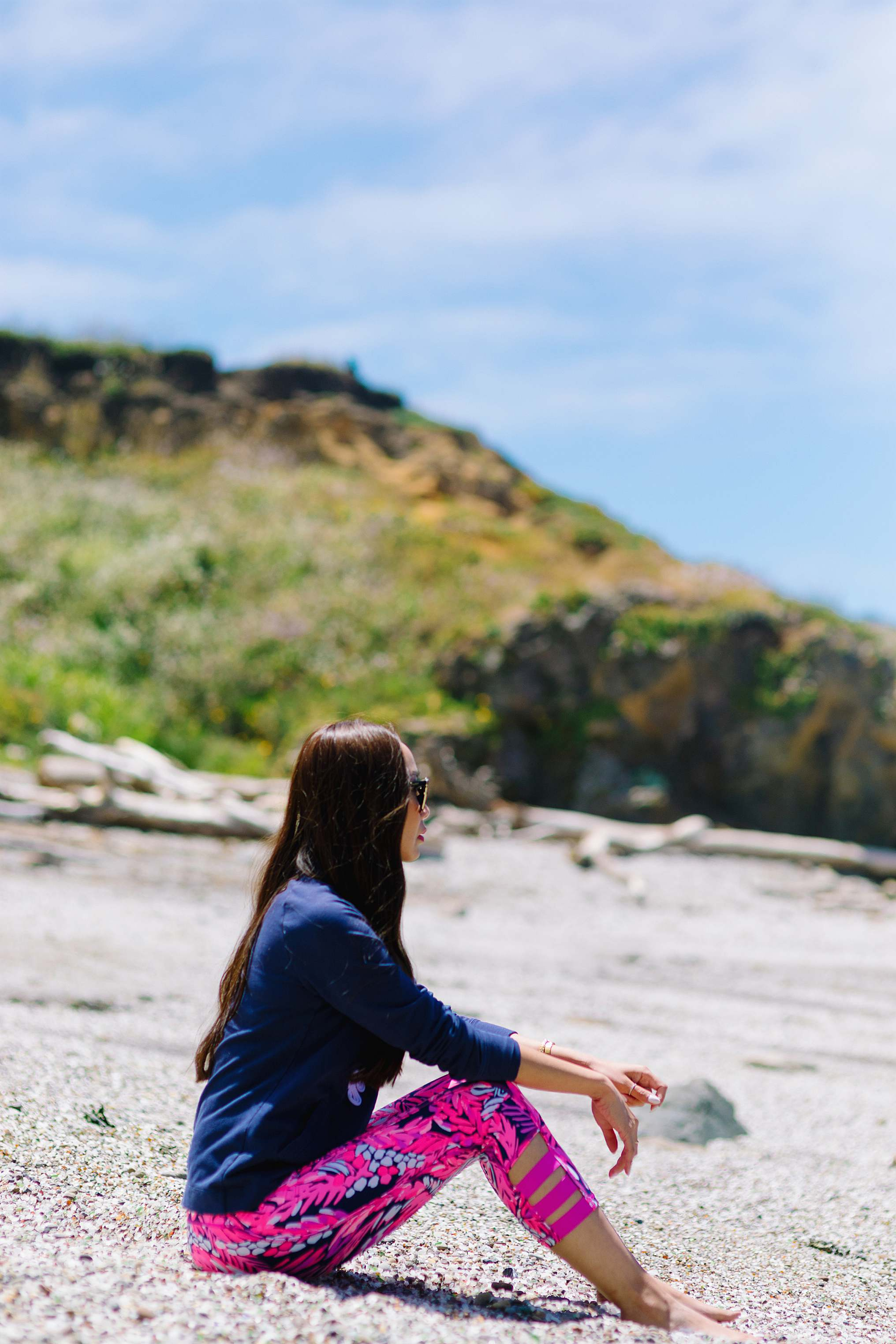 Diana Elizabeth blogger in Lilly pulitizer siting on glass beach in California Fort Bragg