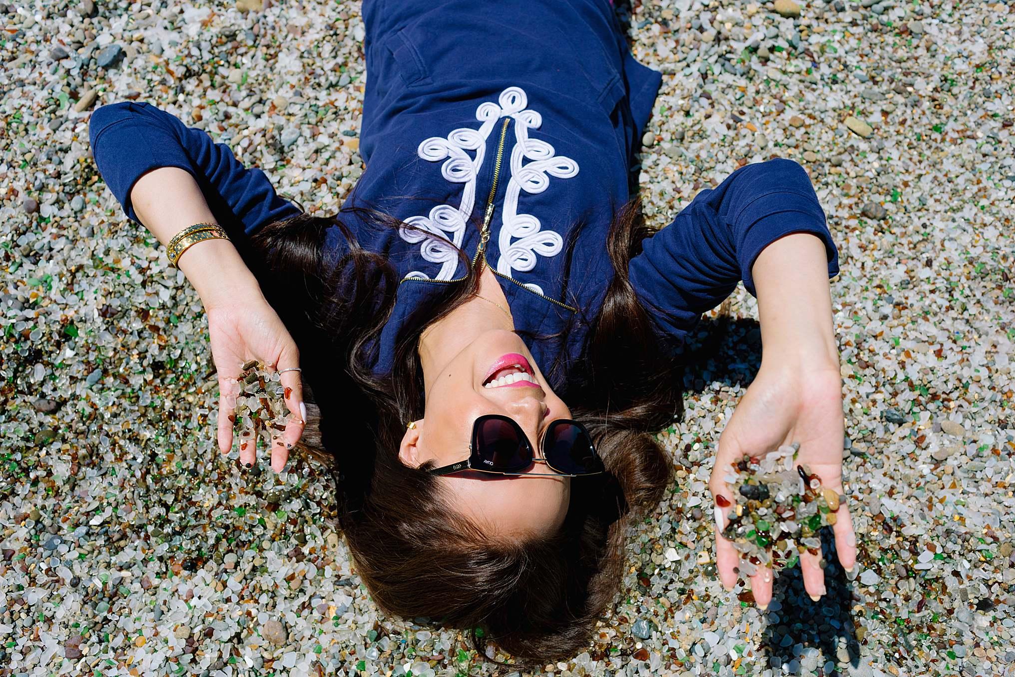 glass beach Mendocino County California lifestyle blogger Diana holding glass beach sand