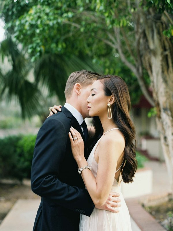 couples pose idea engagement wedding shoot Inspo bridal engagement photo idea white tulle dress glam engagement shoot brandy Jackson film photographer lifestyle blogger Diana elizabeth