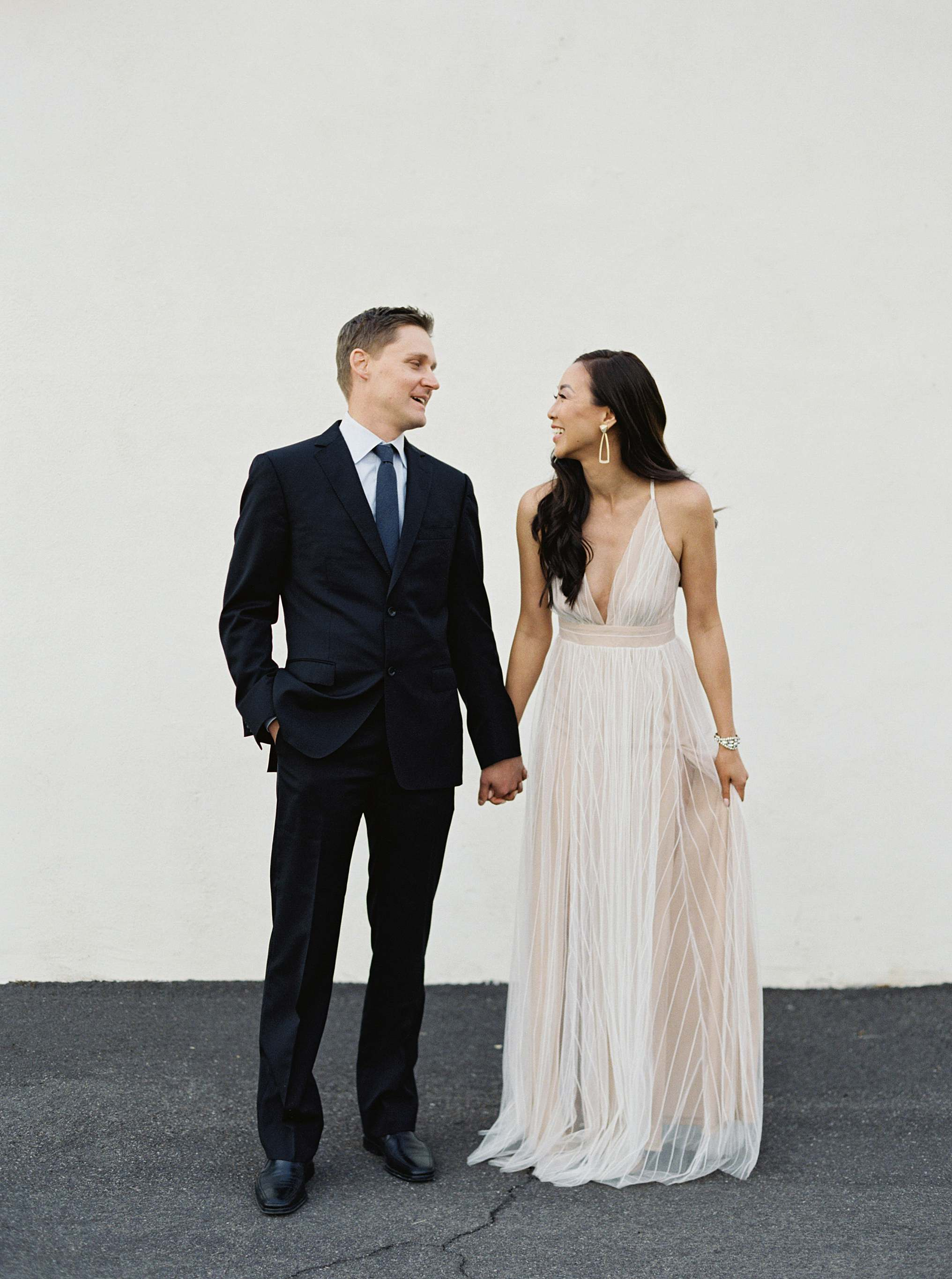 couple pose idea clean white background engagement wedding shoot Inspo bridal engagement photo idea white tulle dress glam engagement shoot brandy Jackson film photographer lifestyle blogger Diana elizabeth