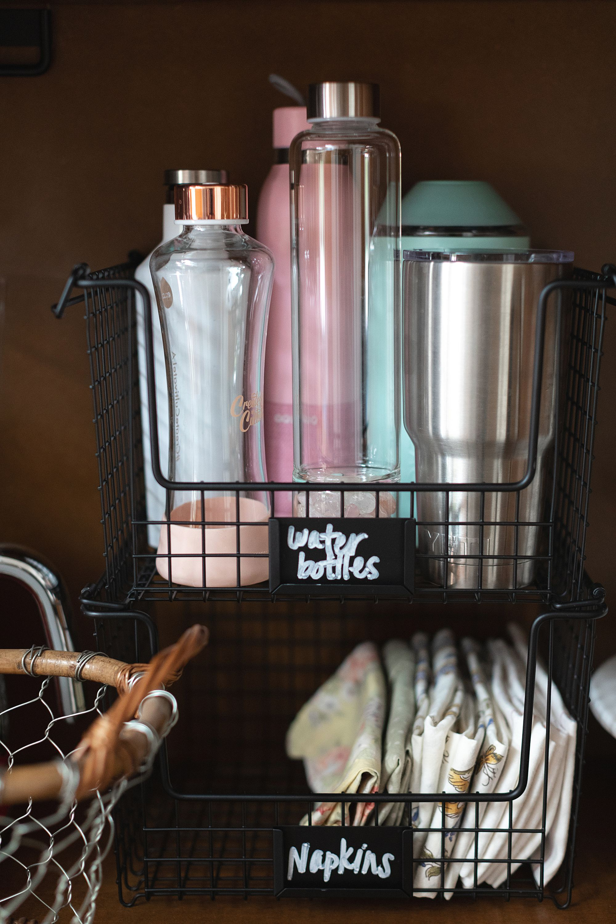 water bottles organization in the kitchen armoire