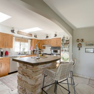 kitchen barstools, flagstone floors, English country cottage style home