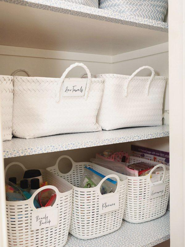 white baskets linen closet