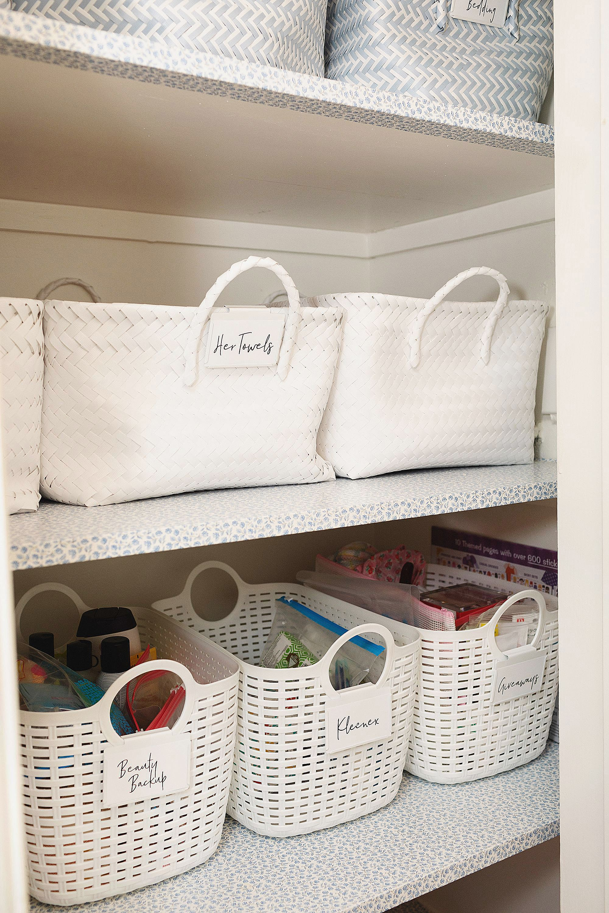 white baskets linen closet