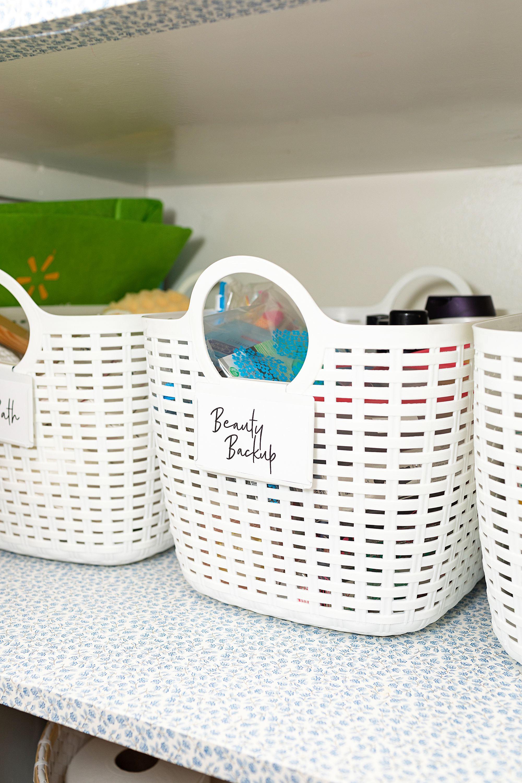 linen closet white basket