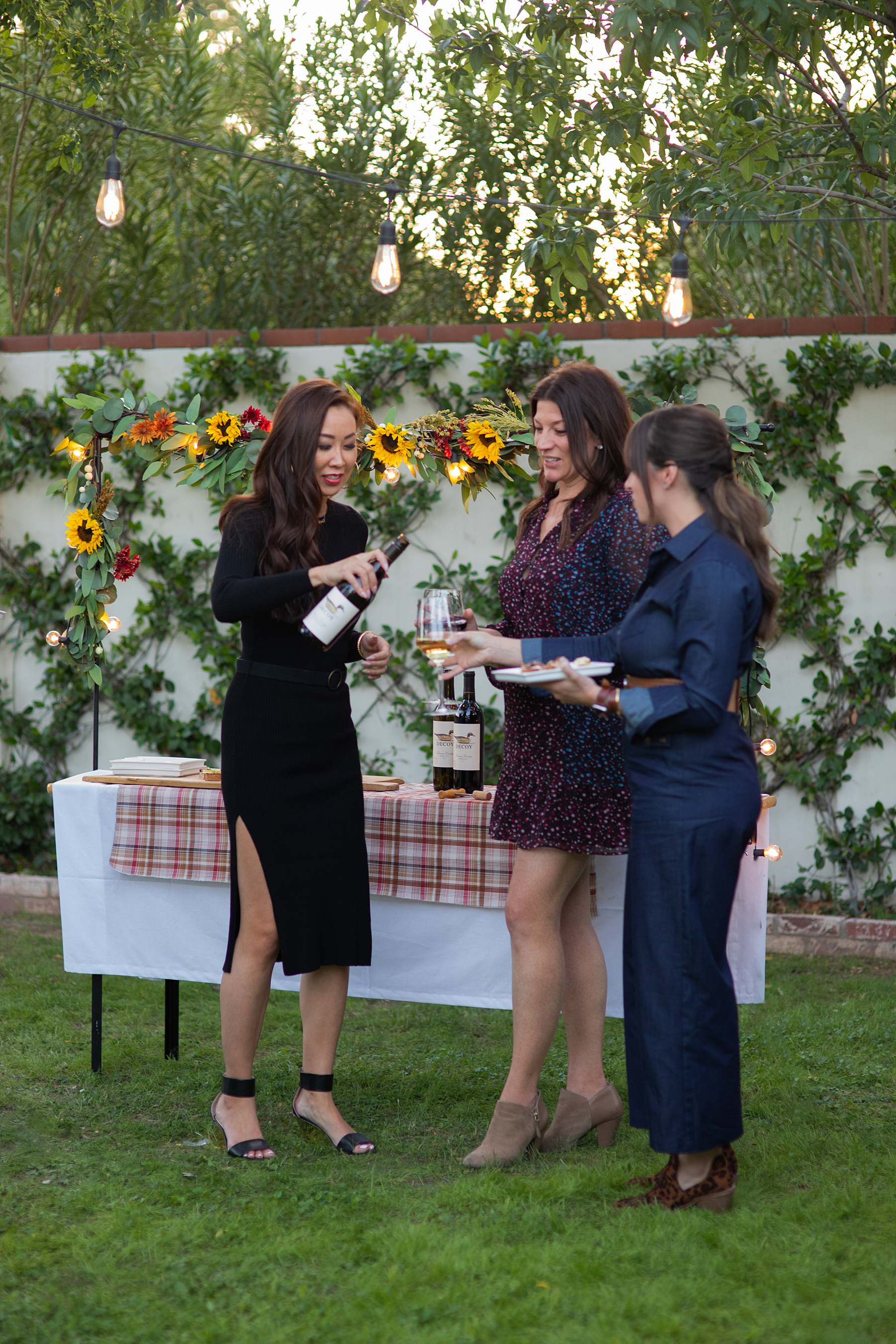 pouring wine backyard party decoy wine night party Friendsgiving outdoor party catch up - Diana Elizabeth blog phoenix lifestyle entertaining hostess blogger