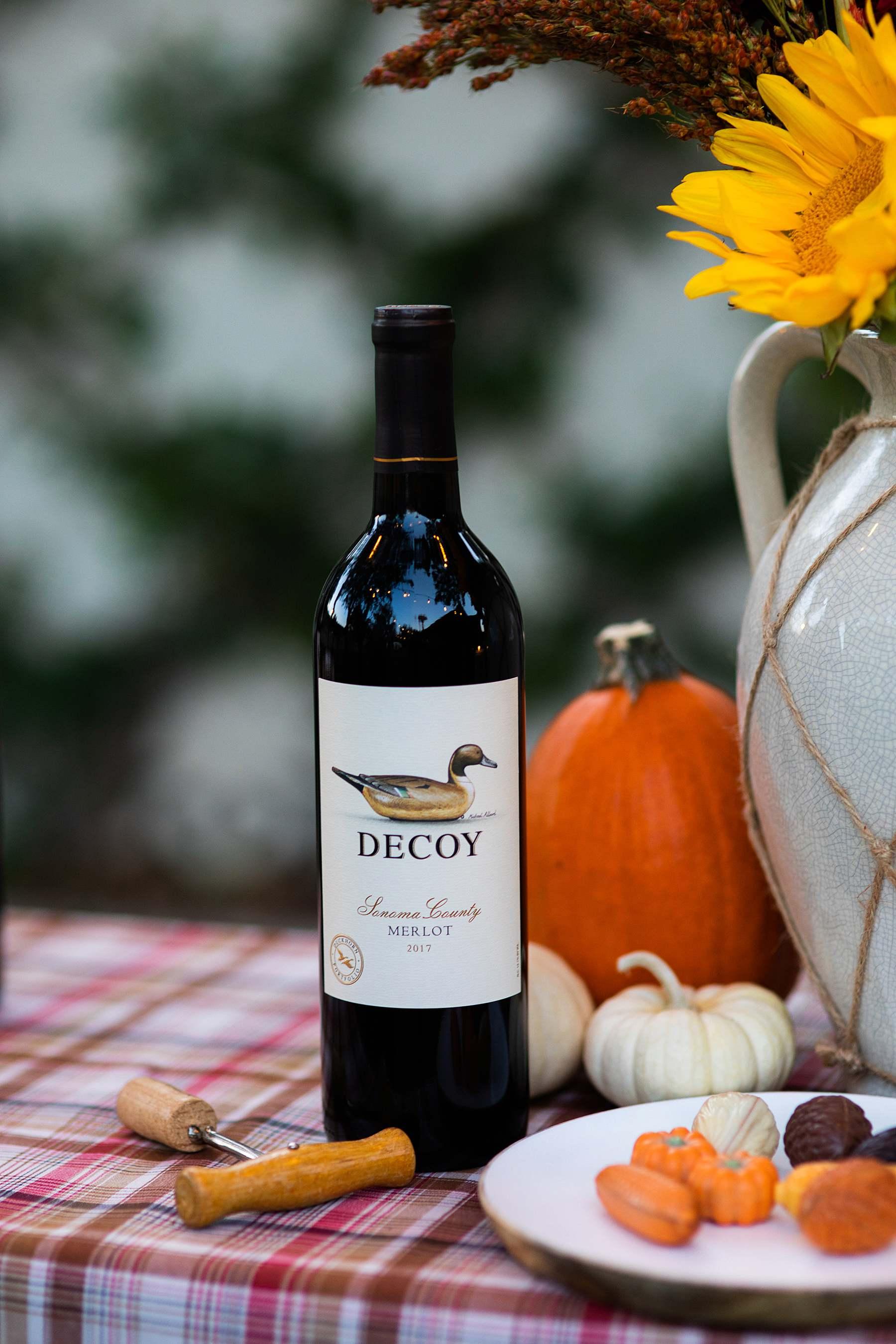 decoy wine on table Friendsgiving idea outdoor tablescape party