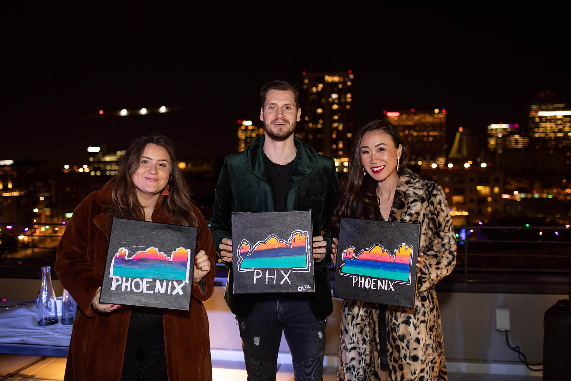showing off our paintings with arizona coyotes captain Oliver at paint night in downtown phoenix Cambria downtown hotel rooftop