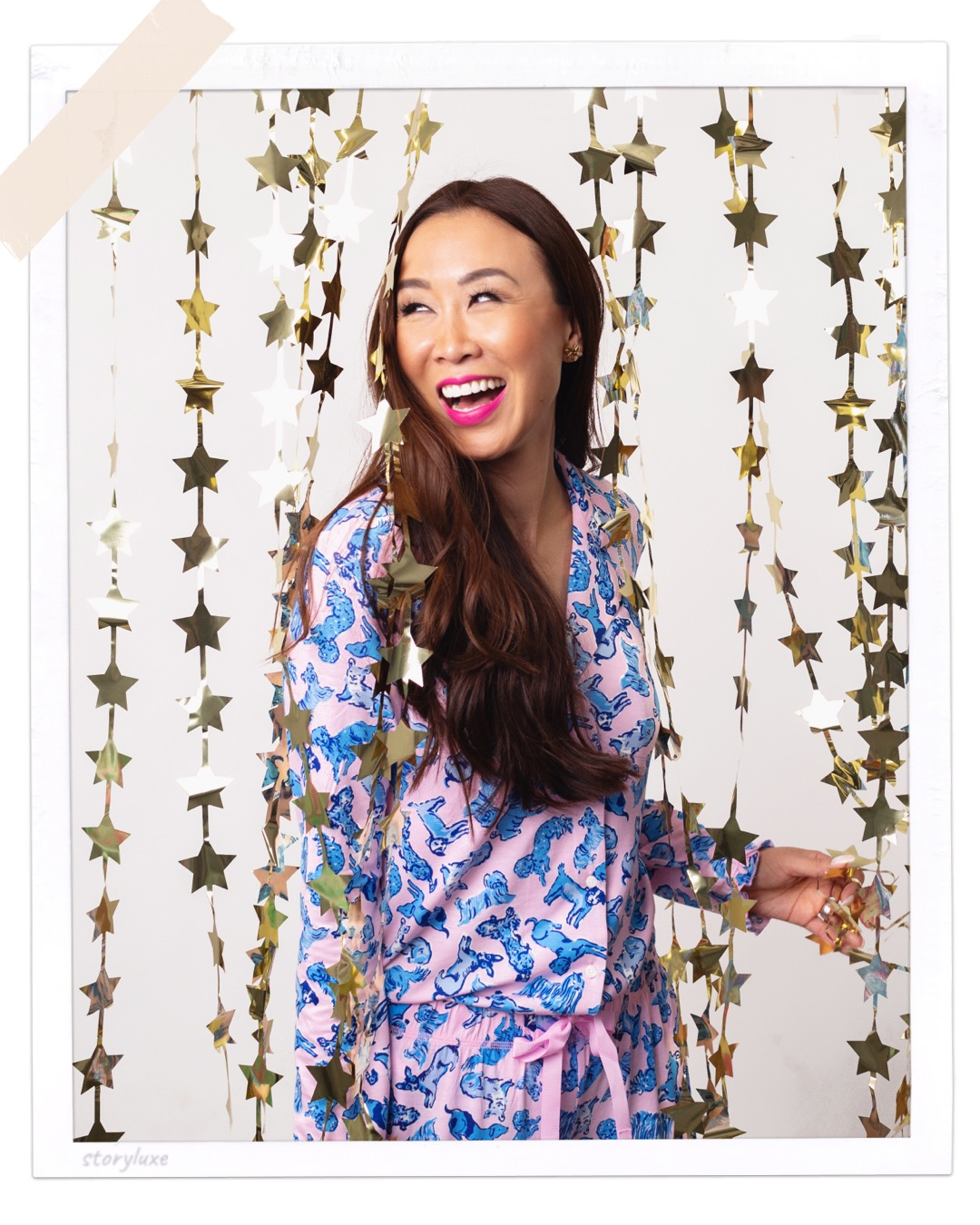 lifestyle fashions style blogger diana elizabeth in front of star curtains wearing doggie print Lilly Pulitzer pajamas