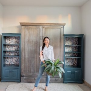 phoenix home blogger Diana Elizabeth in front of Murphy bed with bookshelves and wallpaper