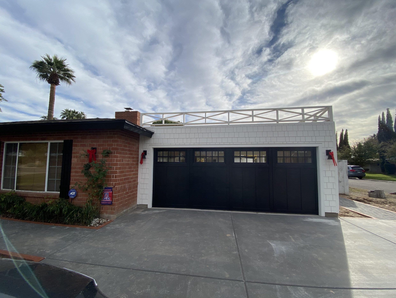 flat roof garage idea with railing, white fiber cement shingles