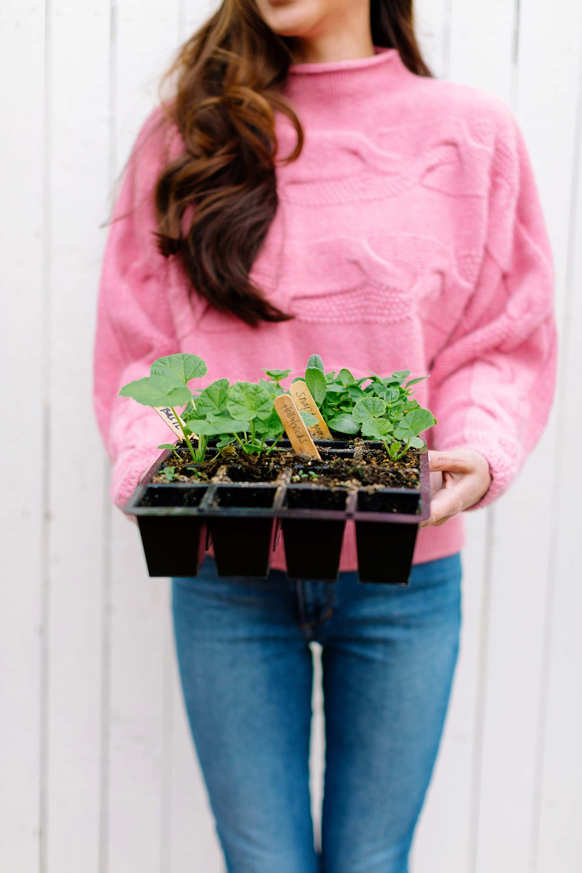 seed starter lifestyle blogger garden blog Diana Elizabeth holding tray of starters