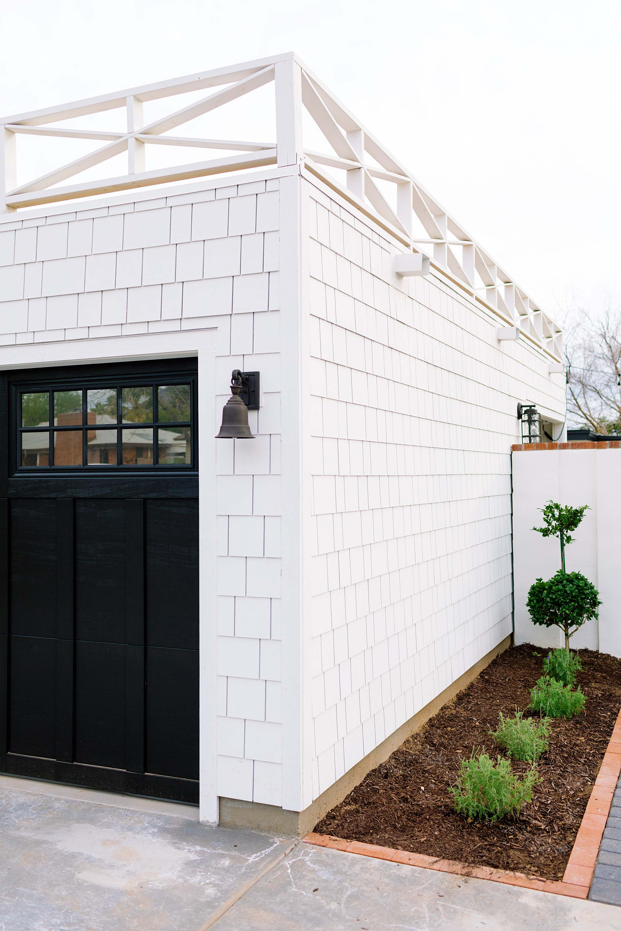 side gate of garage to garden area double topiaries and fern leaf lavender