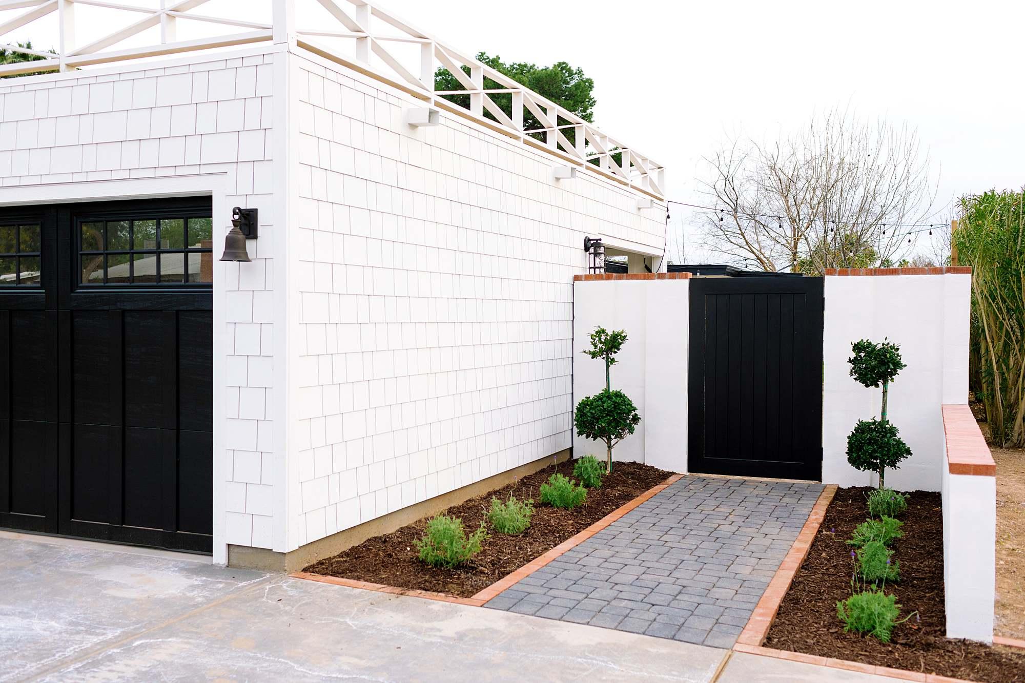 front yard gate side of flat roof garage fiber cement shake traditional black and white home garage - arizona phoenix blogger home blog Diana Elizabeth